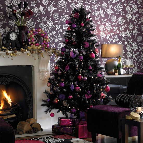 A simple black tree decorated in complimentary colors of purple ...