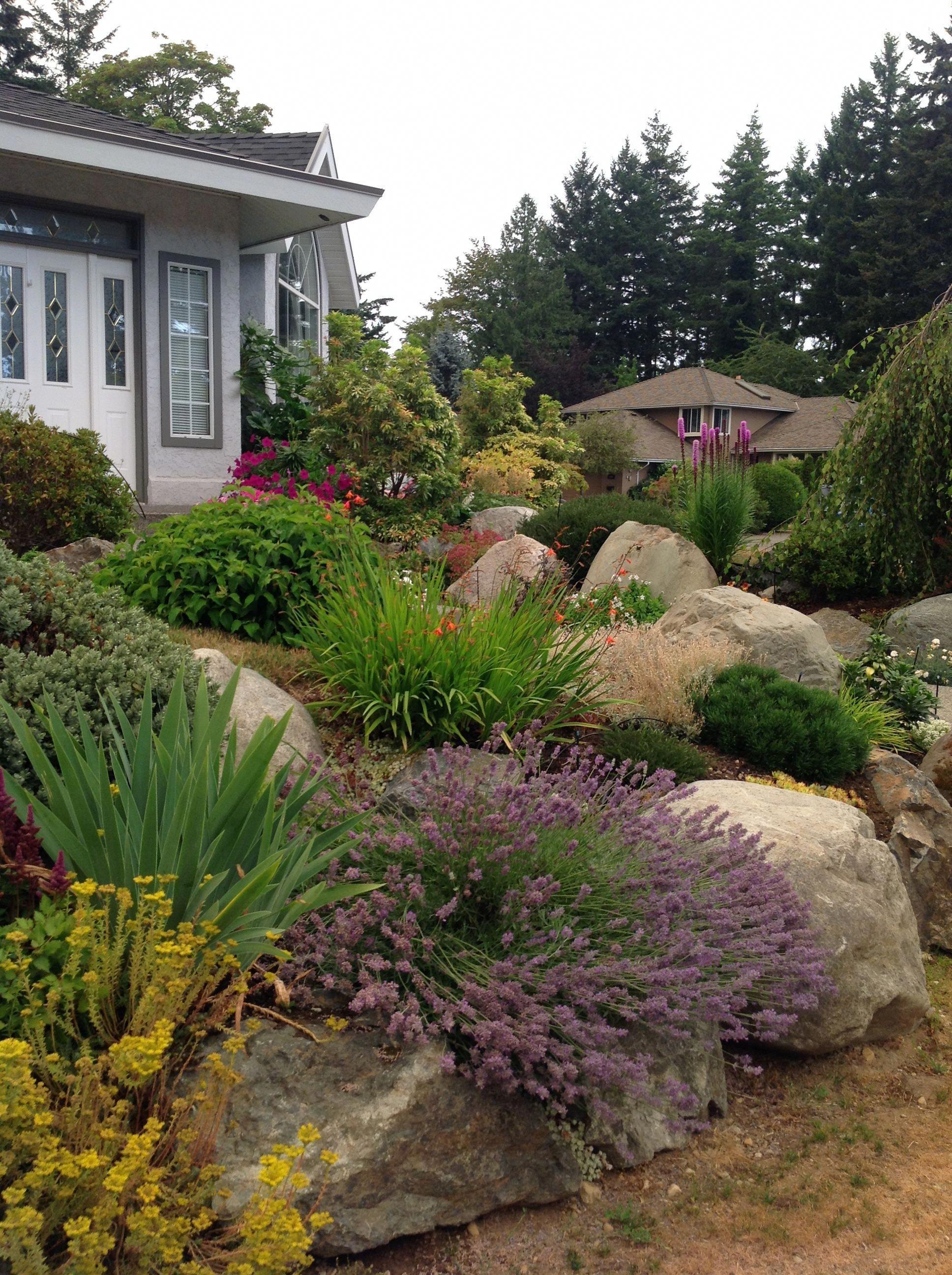 Landscaping A Corner Lot Landscaping With Rocks Front Yard Landscaping Landscape Design