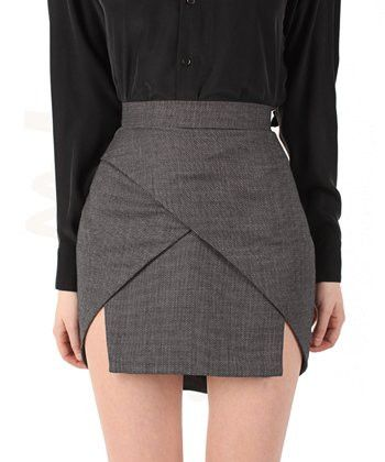 This tailored wool skirt is anything but traditional! A very modern silhouette from Bedford St Laundry...