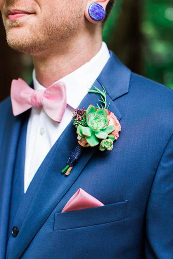 navy blue groom or groomsmen with succulent boutonniere ...