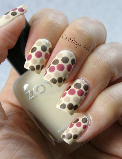 DOTS! CraftyNail used Zoya Jacqueline for the base, then putty colored dots of OPI Don't Pretzel My Buttons, brown shimmery dots of Maybelline Ultimate Wear in Tarnished Taupe (old color), and mauve dots of Sally Hansen Teflon Tuff in Wood Violet Cream (another old color).