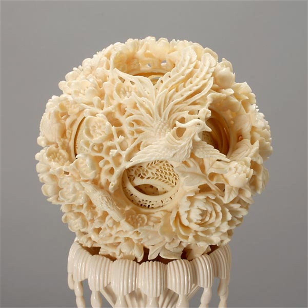 A large ivory puzzle ball and stand bone carving