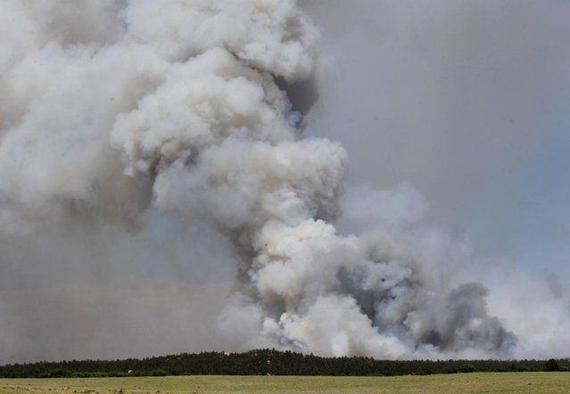 A fire burns out of control north of Shoupe Road and East of Highway 83 in Colorado Springs, Colo. on Tuesday afternoon, June 11, 2013. (Photo by Christian Murdock/AP Photo/The Colorado Springs Gazette) http://avaxnews.me/fact/Colorado_Fires_Growing.html