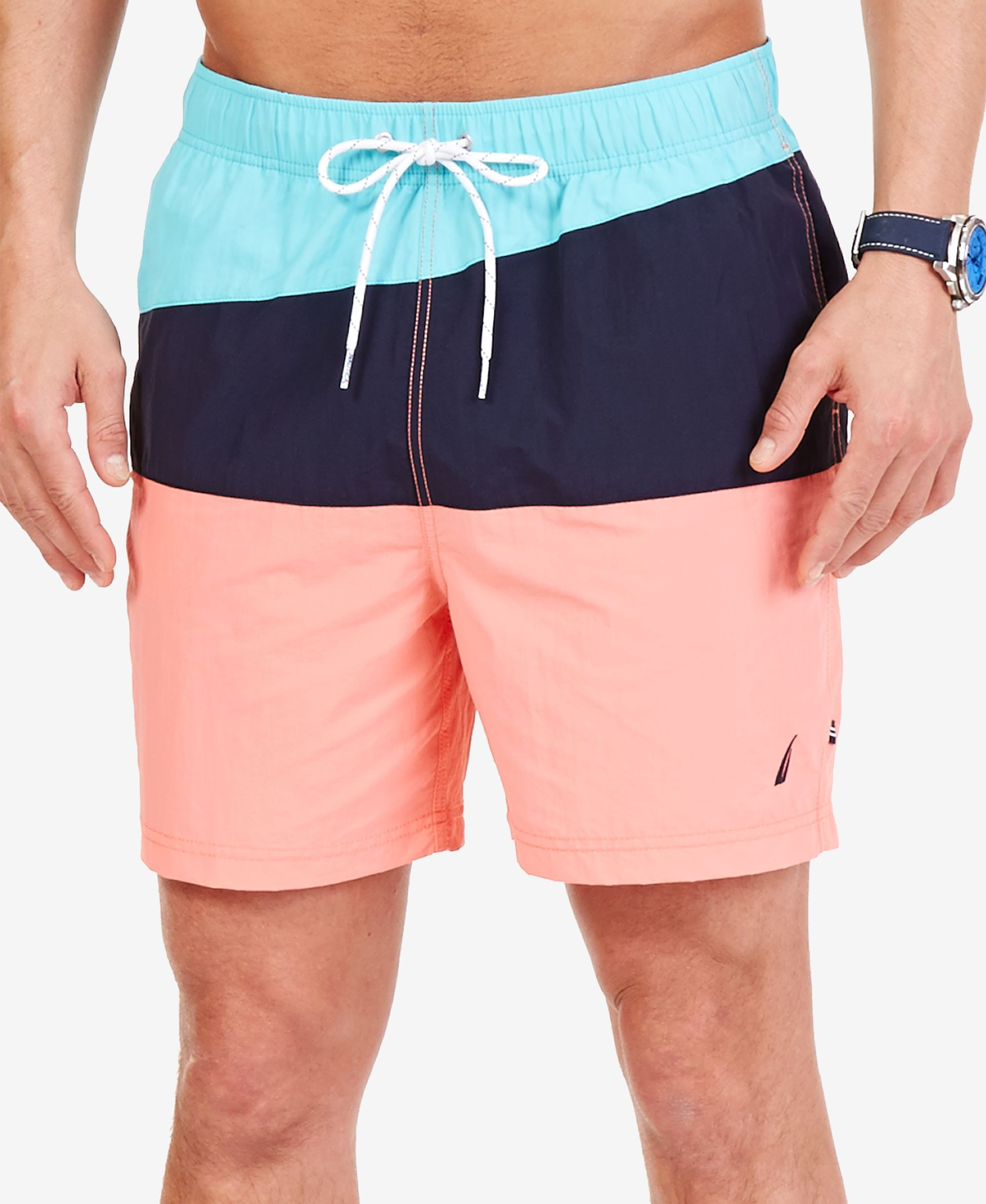 b901eb4389 A colorblocked design lends bold style to the functional quick dry fabric  of these swim trunks