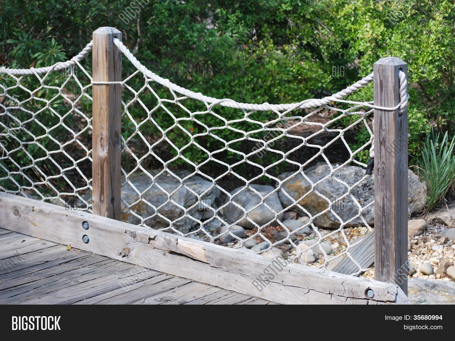 Nautical net rope fence diy home pinterest rope fence for Garden decking with rope