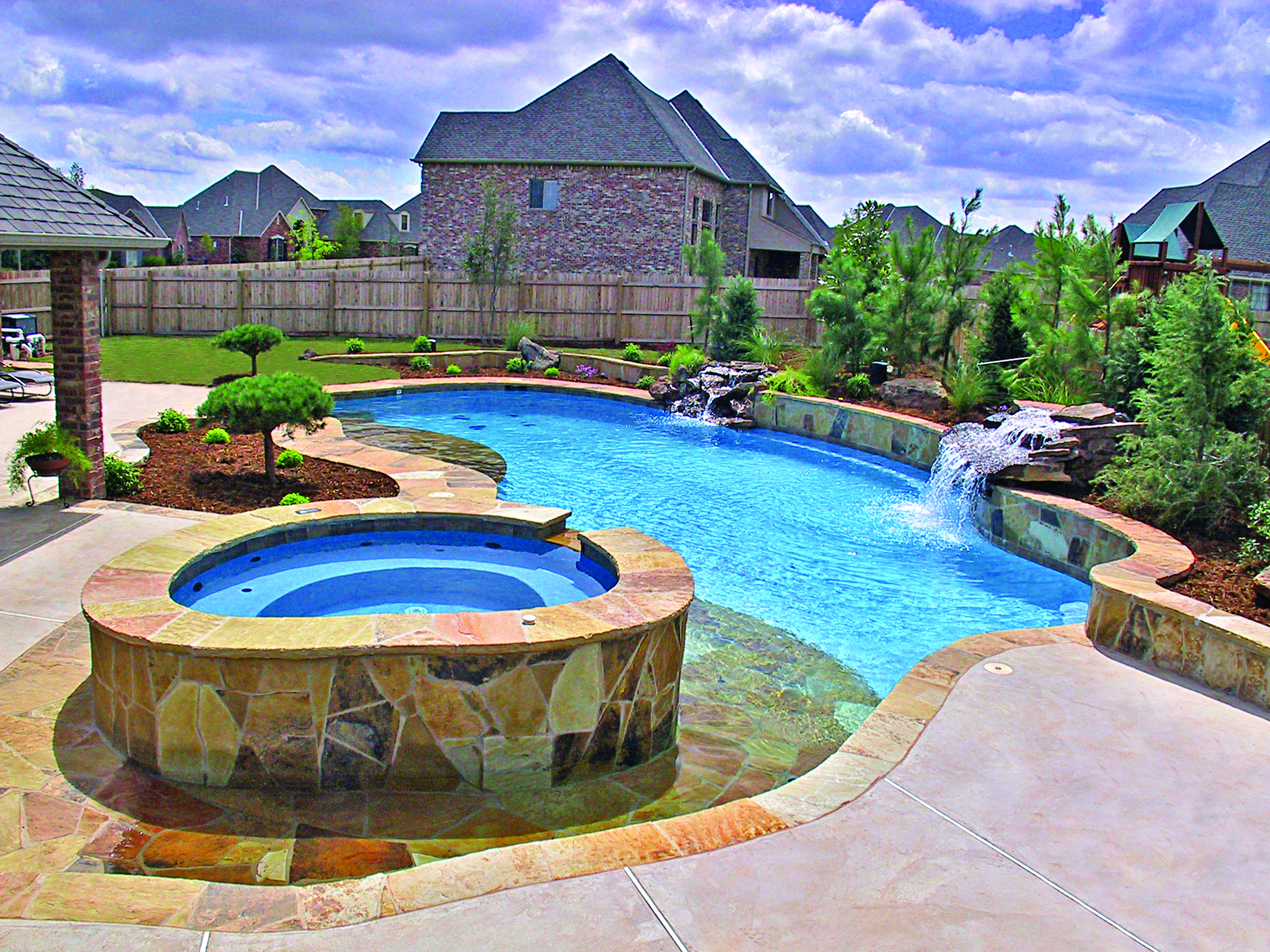 Blue haven beach entry pool with spa and waterfall located for Pool design okc