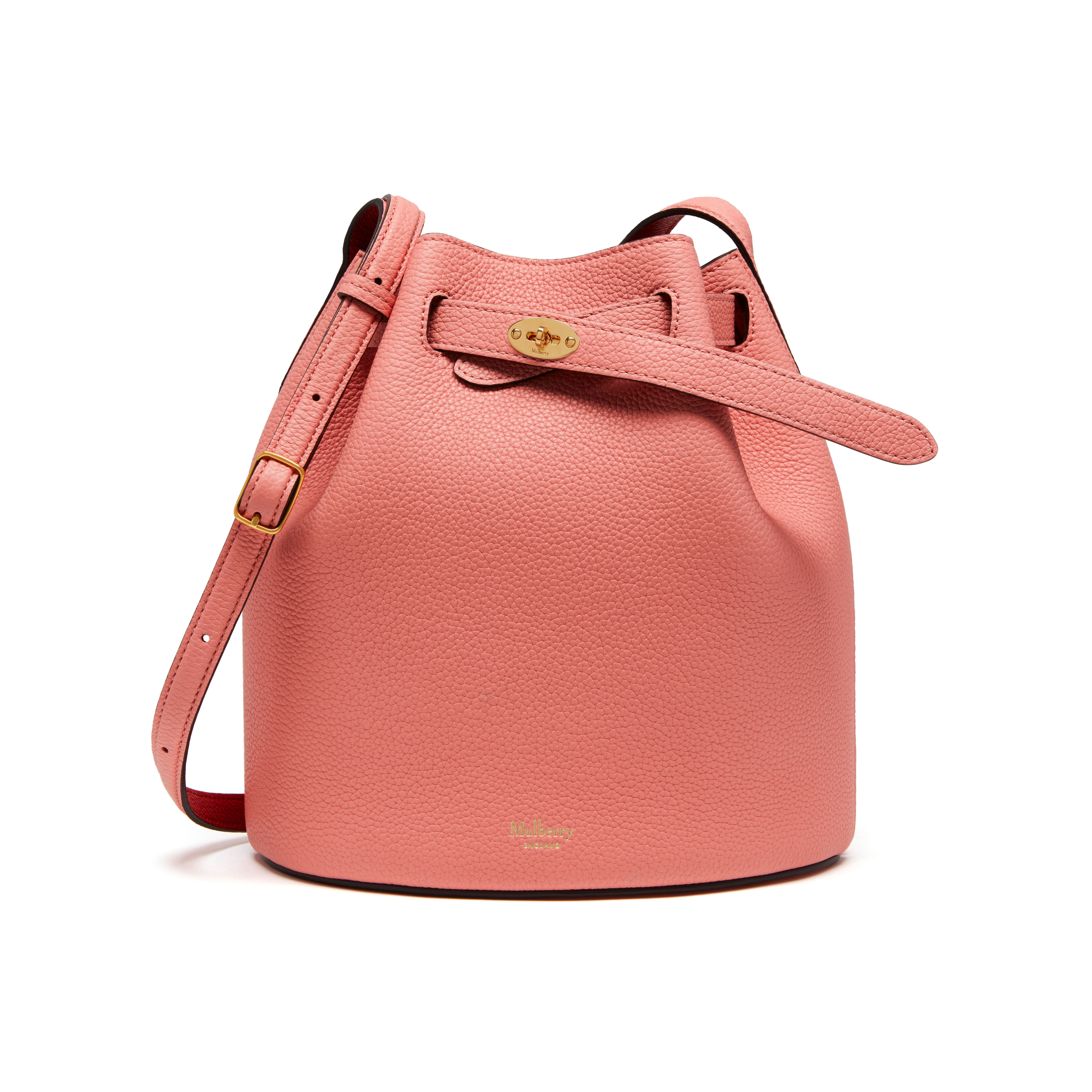 Shop the Abbey in Macaroon Pink & Scarlet Small Classic Grain Leather at Mulberry.com. The Abbey is a traditional 'bucket bag' with drawstring detailing, contrast lining and a range of eye-catching or iconic leather finishes. The Abbey features the iconic postman's lock as a nod to Mulberry's heritage DNA, securing a simple belt closure on a timeless, easy to wear style.