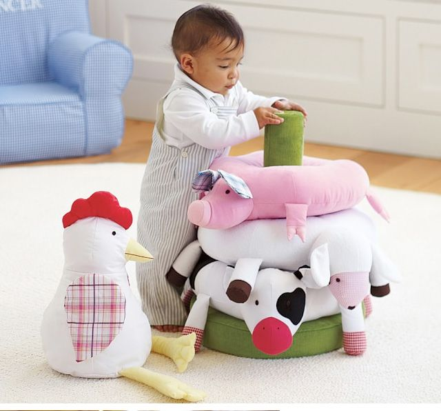 This cutie is having a great time with his super fun Farm Stacker learning toy!