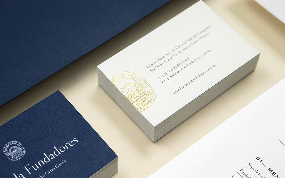 hacienda fundadores business card with gold foil print finish designed by anagrama