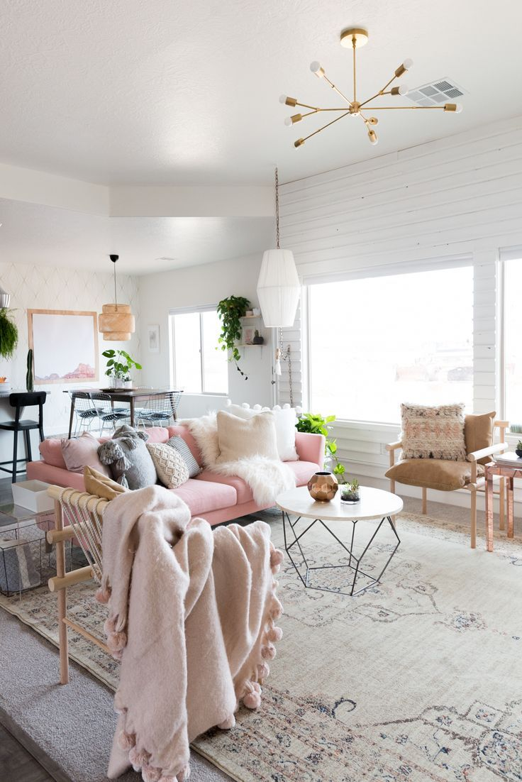 This Living Room Is So Collected And Cozy Love The Pink Couch Brass Light Dowel Chairs