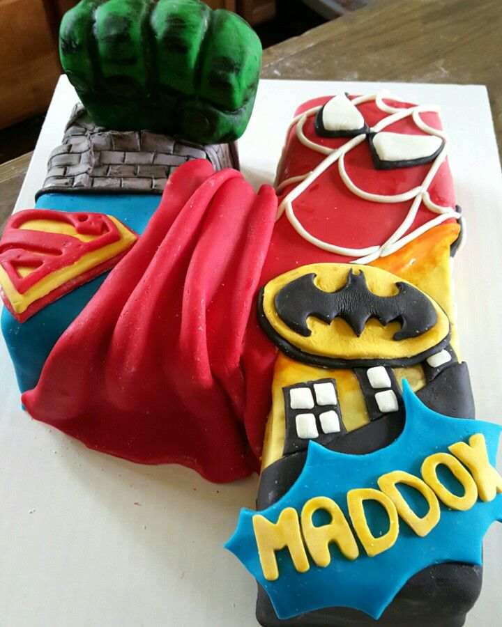 MarvelDC comics super hero cake with the number 4 complete with 3D