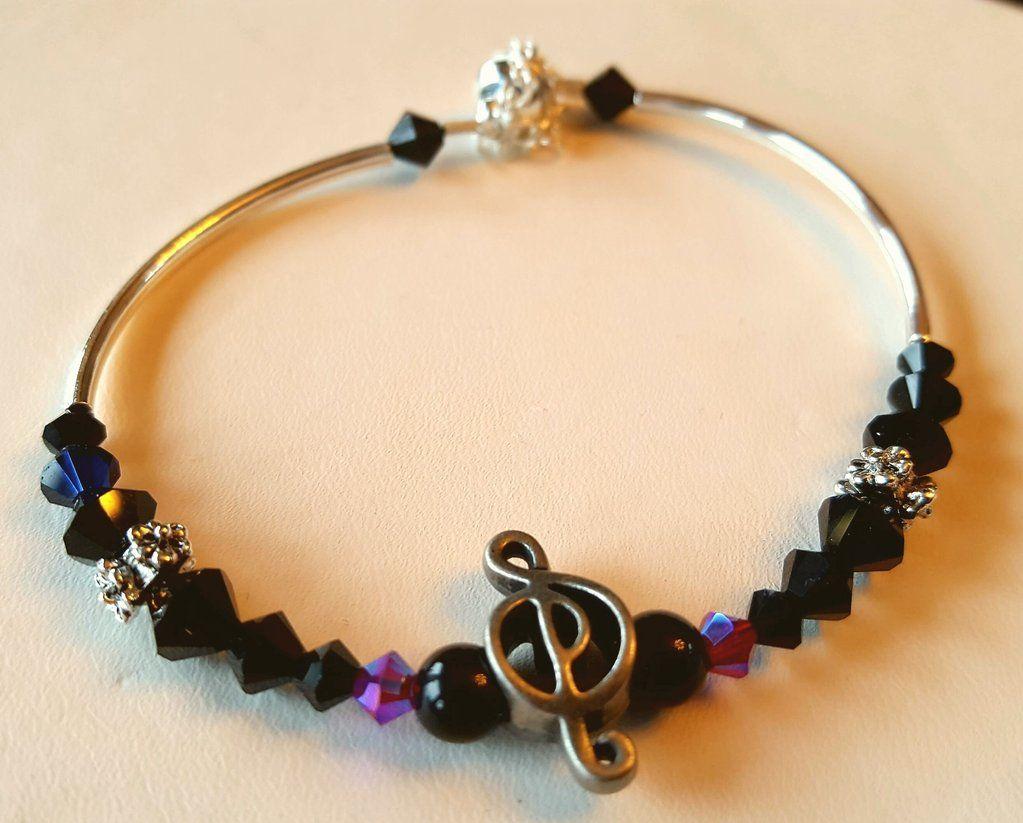 Crystal clasp bracelet 018 blk g treble clef