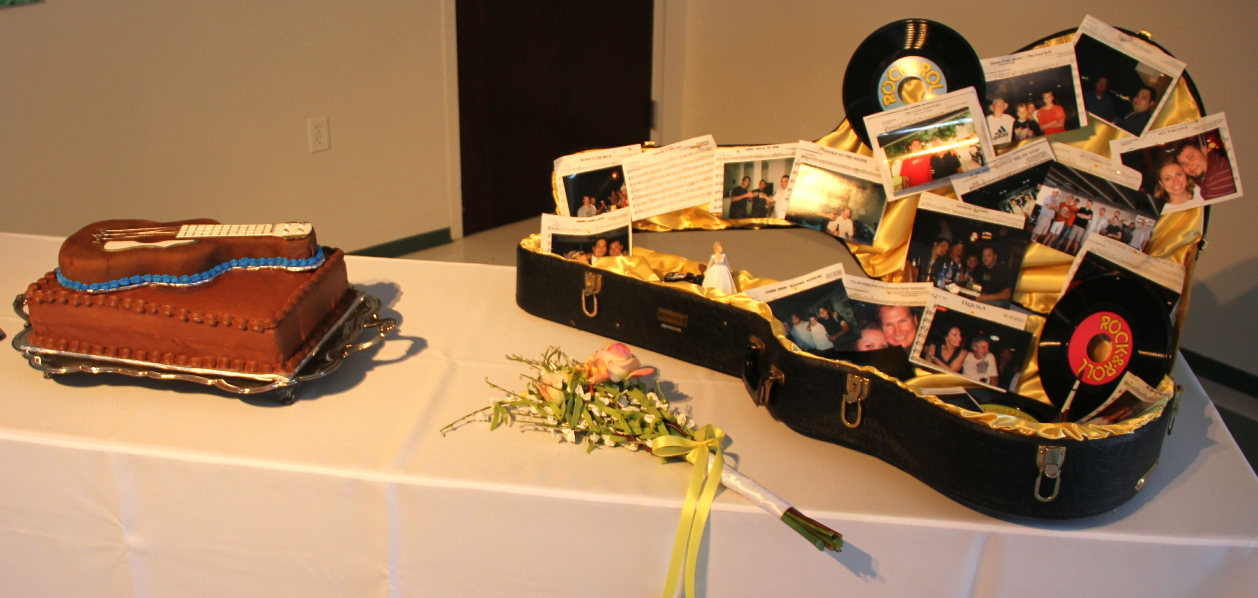 The guitar case is so cute for a little memory box! Ask guests to write words of encouragement, etc., and put them in!