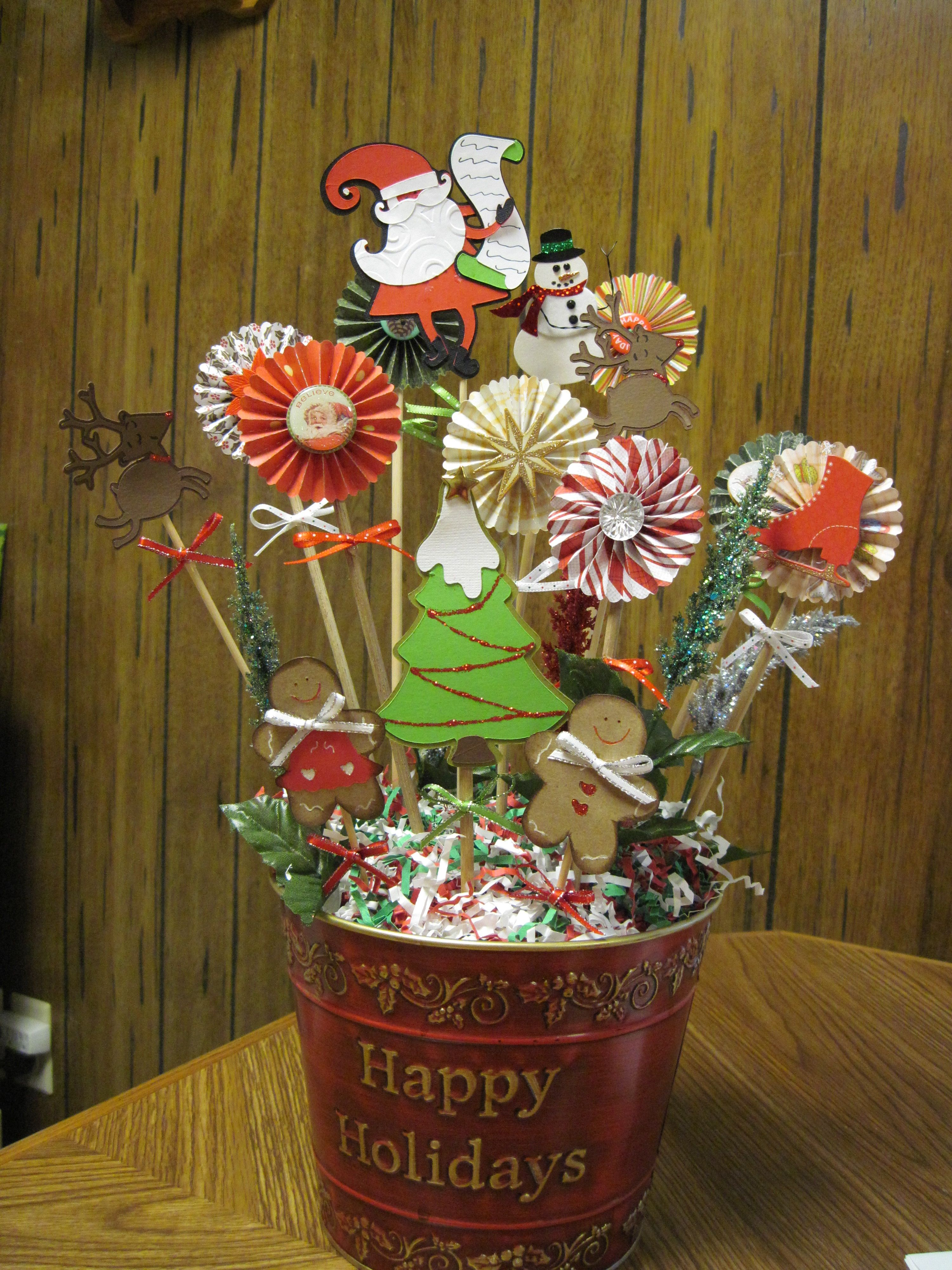 Christmas centerpiece made with Cricut and rosettes