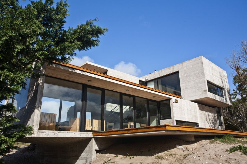 Modern Concrete Beach House Located straight on an Argentinian beach
