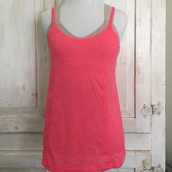 Lululemon tank Lululemon work out top. Pink/Tan. The tan built in sports bra has a light desert camo print. Pink top has faint horizontal stripes. New without tags....washed and never wore it. lululemon athletica Tops