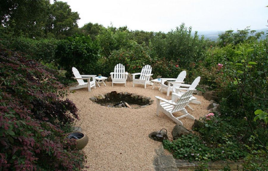 Pea gravel patio area with naturalistic sunken fire pit for Gravel fire pit area