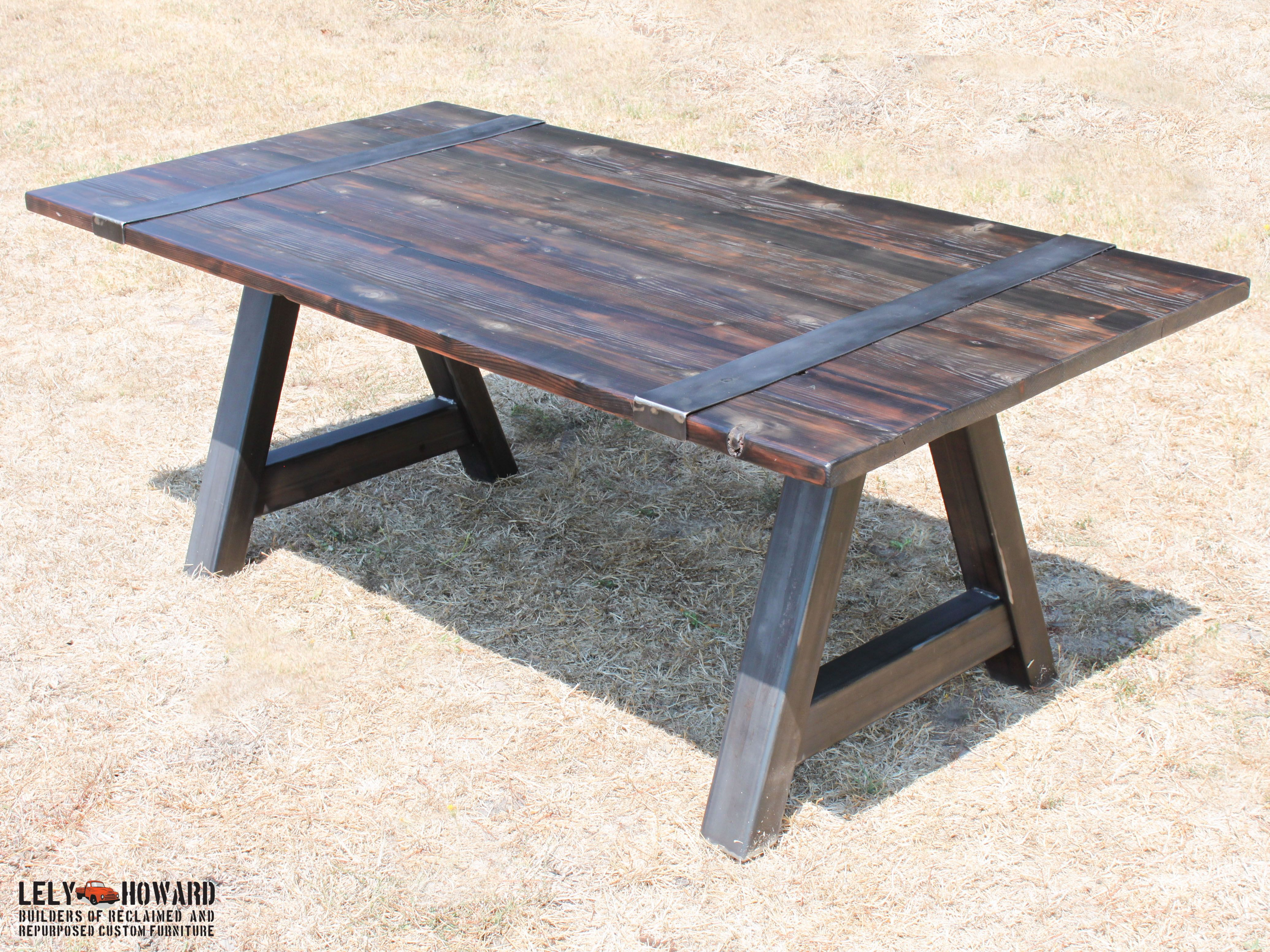 This Dining Table features a Steel A Frame