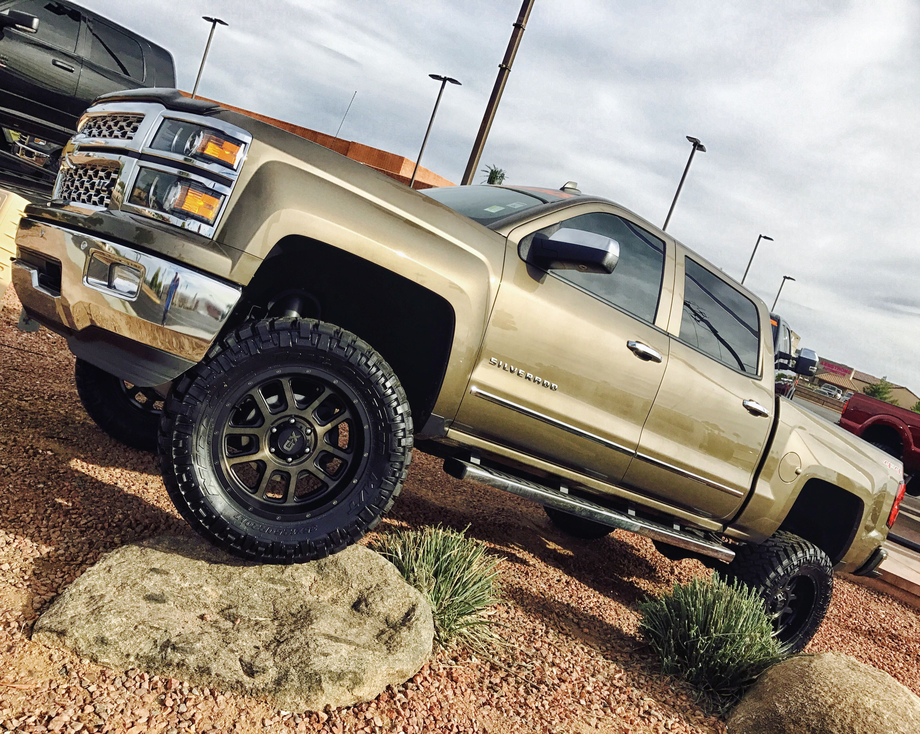 Lifted trucks built chevy 4x4 nitto tires kmc wheels pro comp offroad suspension