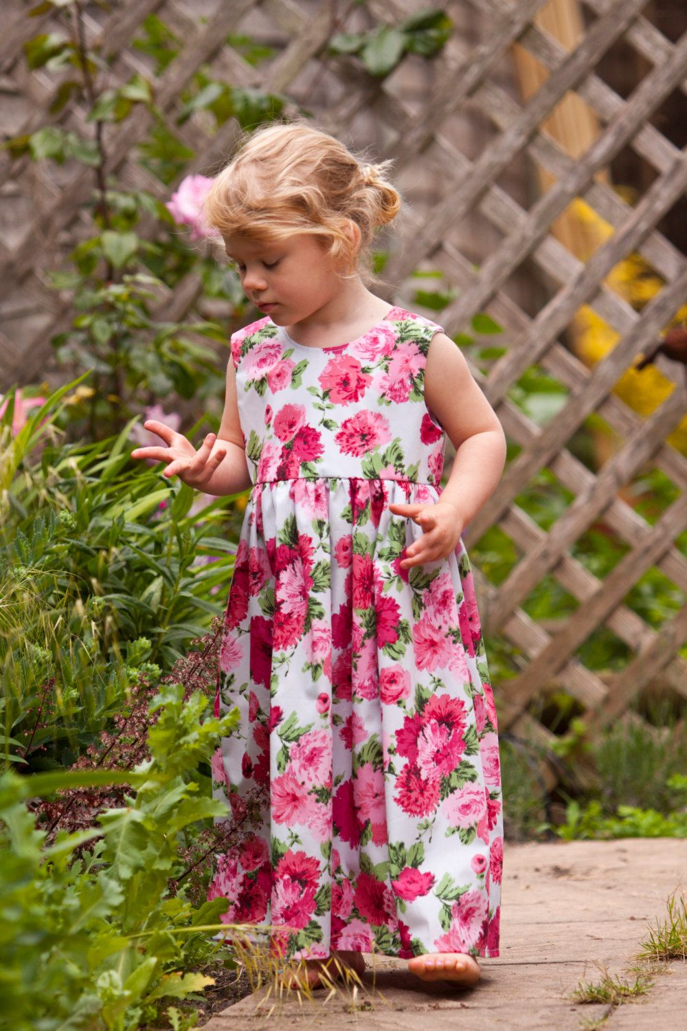 A personal favourite from my Etsy shop https://www.etsy.com/uk/listing/237673301/little-girls-floral-pink-maxi-dress-age