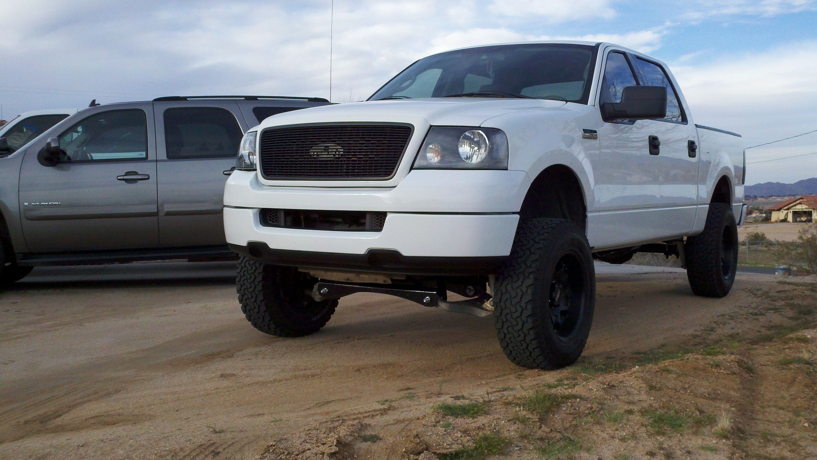 White jacked ford f 150 truck