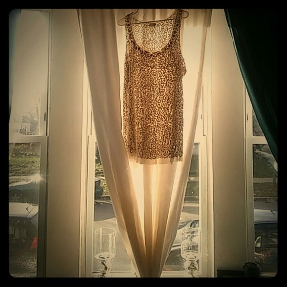 Sequined SHEER Sleeveless Top Gold Stone Embellishments around the decolletage (neck/cleavage area) Sheer cream colored fabric with Gold Metallic Sequins Perfect for a night out worn under a tailored blazer and ?? or by itself. Tops Tank Tops