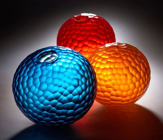 """""""Battuto Sphere Set"""" by Chris McCarthy, $1565. These blown and cold-worked glass orbs are quite stunning."""