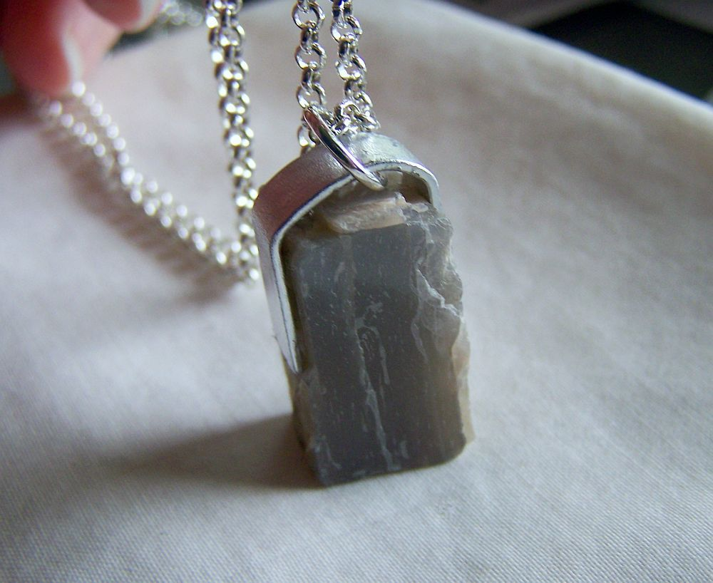 I have wrapped a natural gray moonstone raw gemstone with flat ...