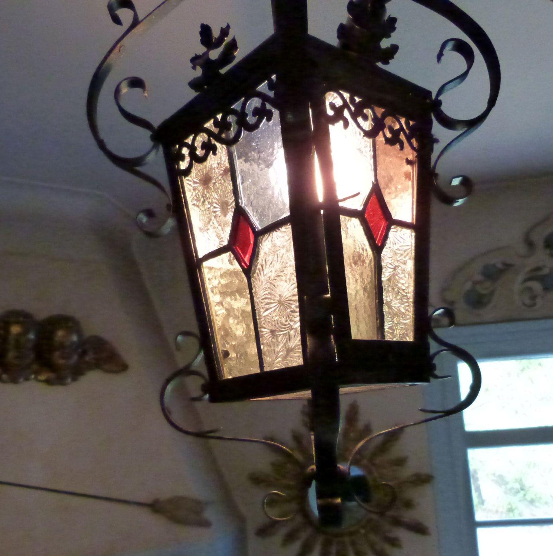 Antique French lantern chandelier made of black handforged iron
