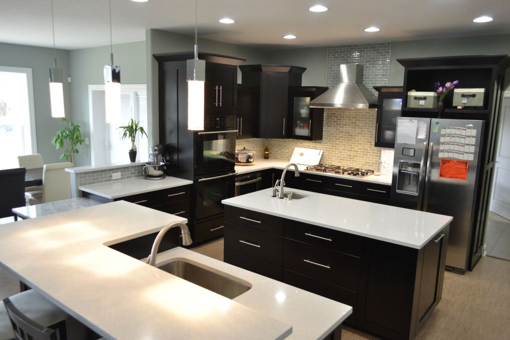 love this kitchen - dark espresso shaker cabinets. ideas for the