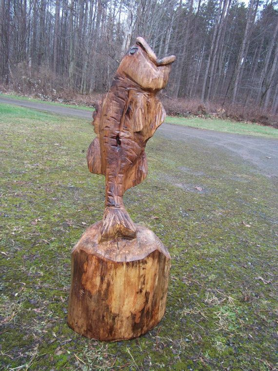 Chainsaw carved maple jumping bass carvings
