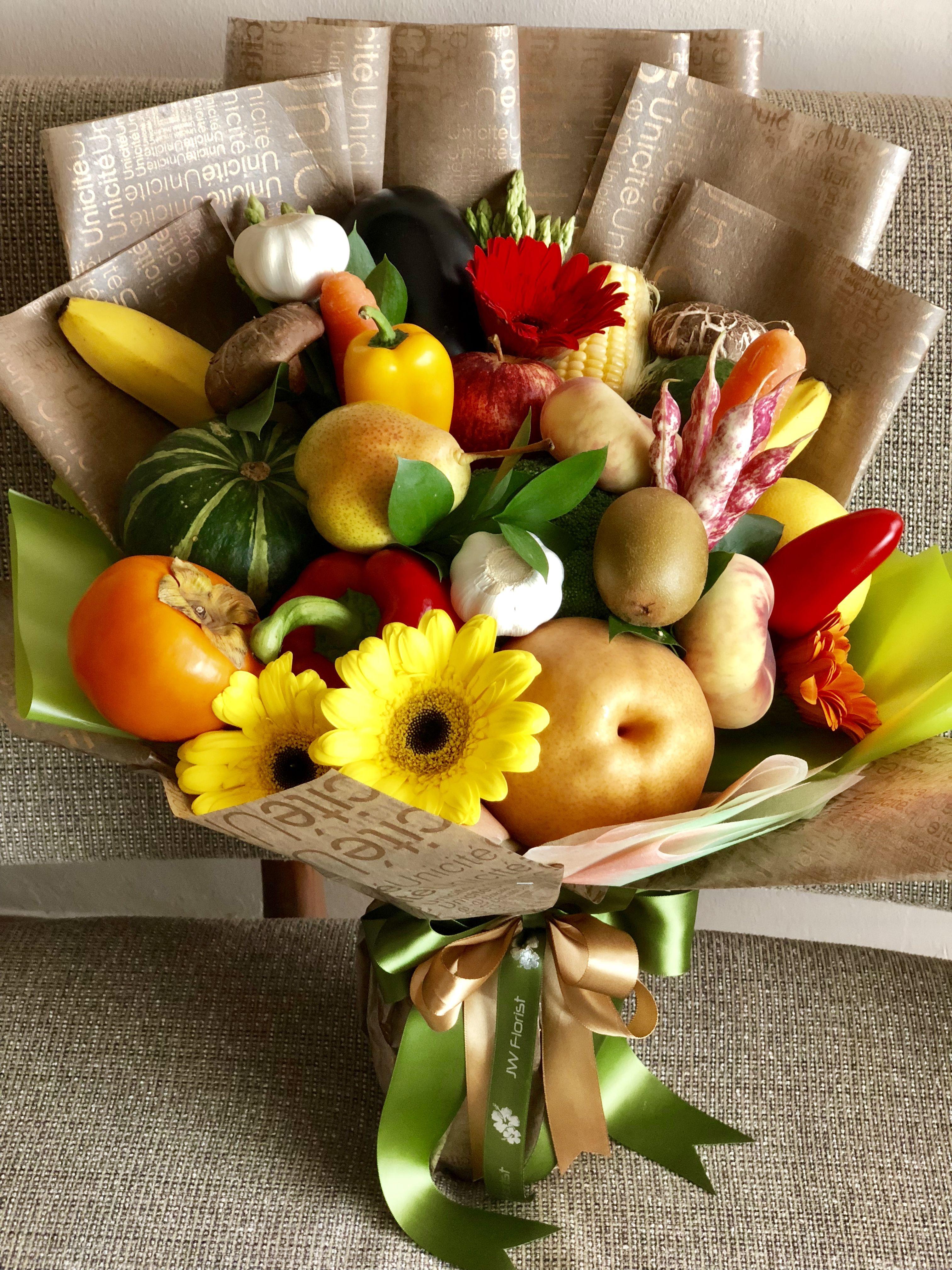 A mixture of fruit and vegetables bouquet flower bouqet
