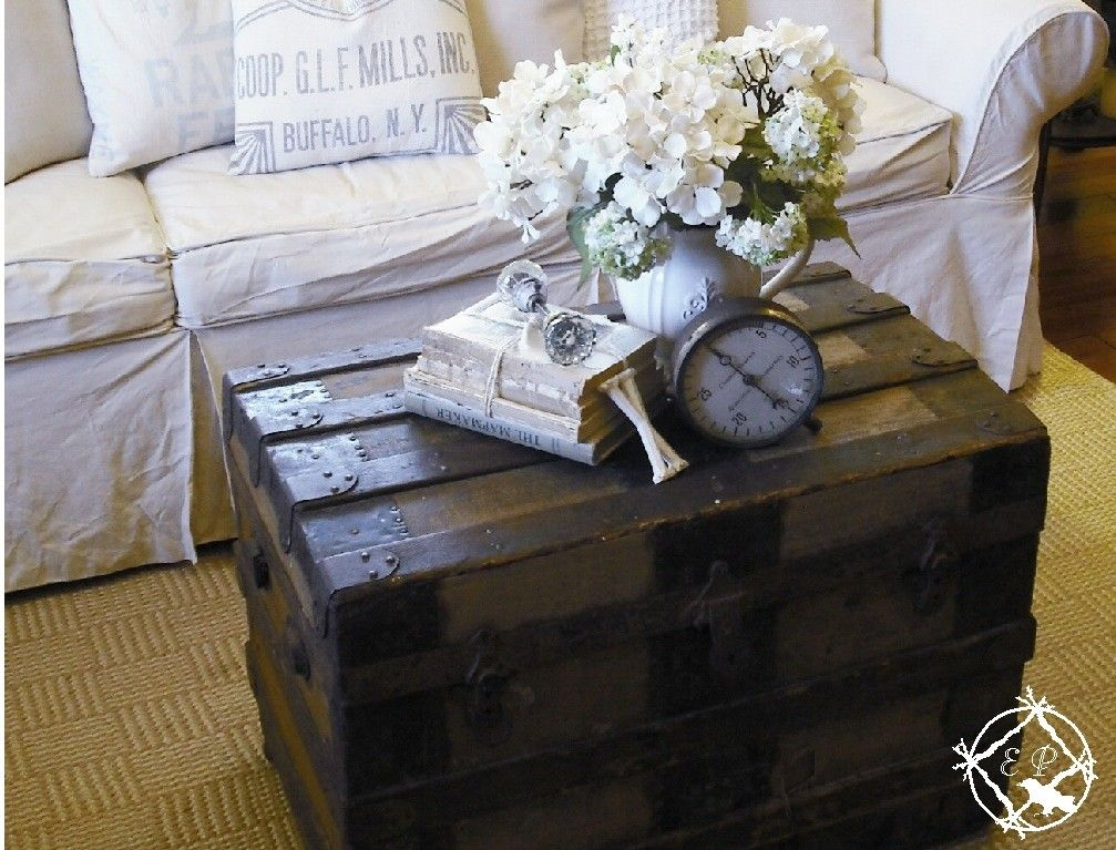living room trunks. Gorgeous room  love the white slipcovers against dark steamer trunk coffee table By Ethereal Plus What I Love for cabin style living 13 best Old trunks images on Pinterest Steamer Suitcases
