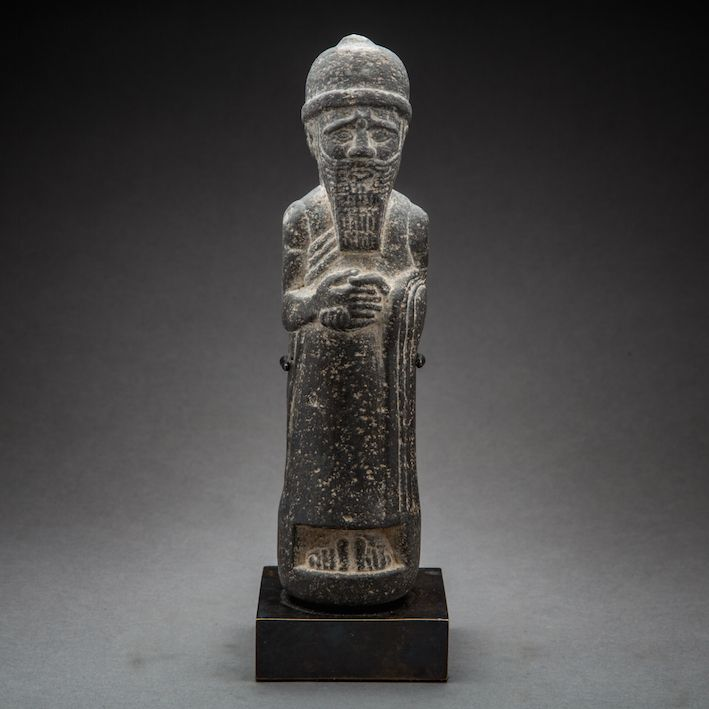 Assyrian stone sculpture of a standing king sf