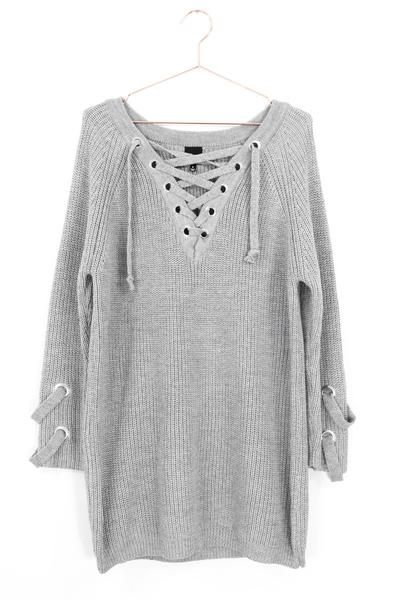 a77c3562d7 Chunky knit sweater with lace-up detailing in front and on sleeve ends.  Long in length with an oversized fit. Size small measures approx. 30.5
