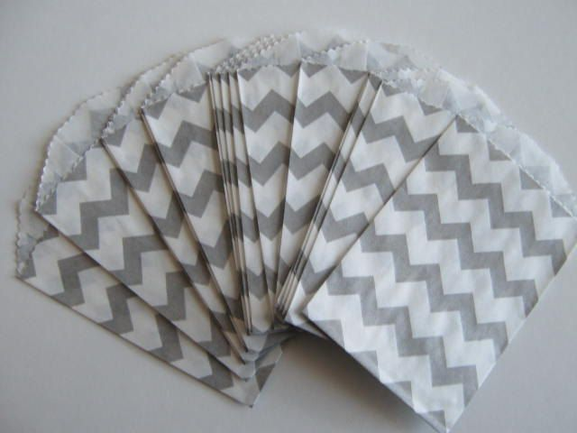 20 Mini Paper Bags, chevron stripes Grey. $4.00, via Etsy. Put the favors in, use clothespin with pinwheel or elephant sticker to close.