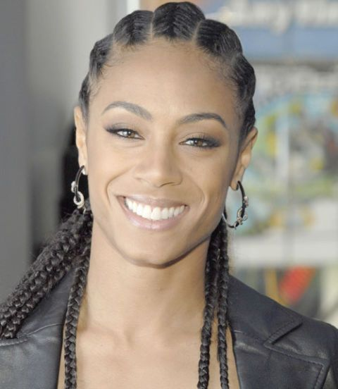 For a crisp pulled-back look that keeps your hair out of your face, try Jada Pinkett Smith's sleek cornrows.