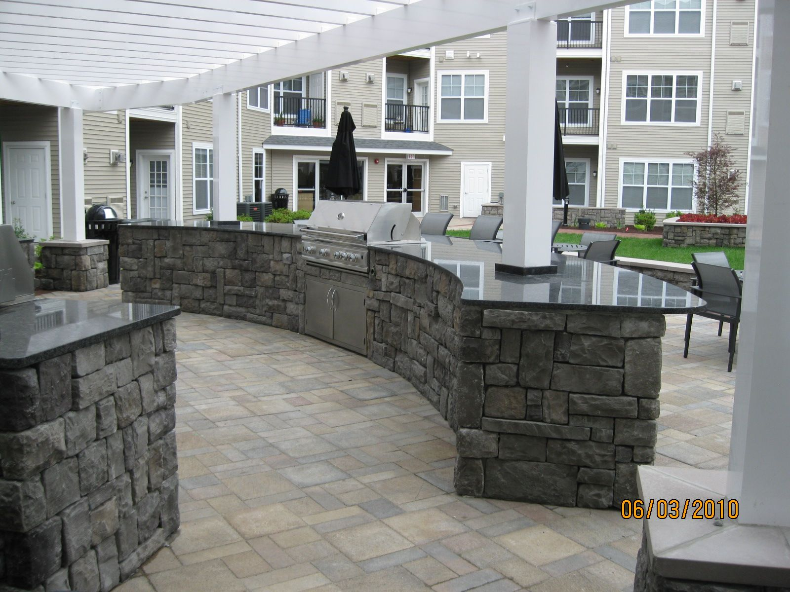 Covered outdoor kitchen outdoor kitchen ideas with stone kitchen - Kitchens Curved Radius With Pergoal Posts Built Right Through Modular Cabinets Outdoor