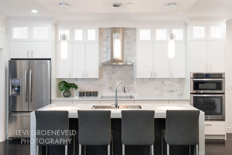 East vancouver residence marble subway tiles white for Kitchen cabinets vancouver island