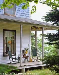 rustic seating for enclosed porch | rocking chairs