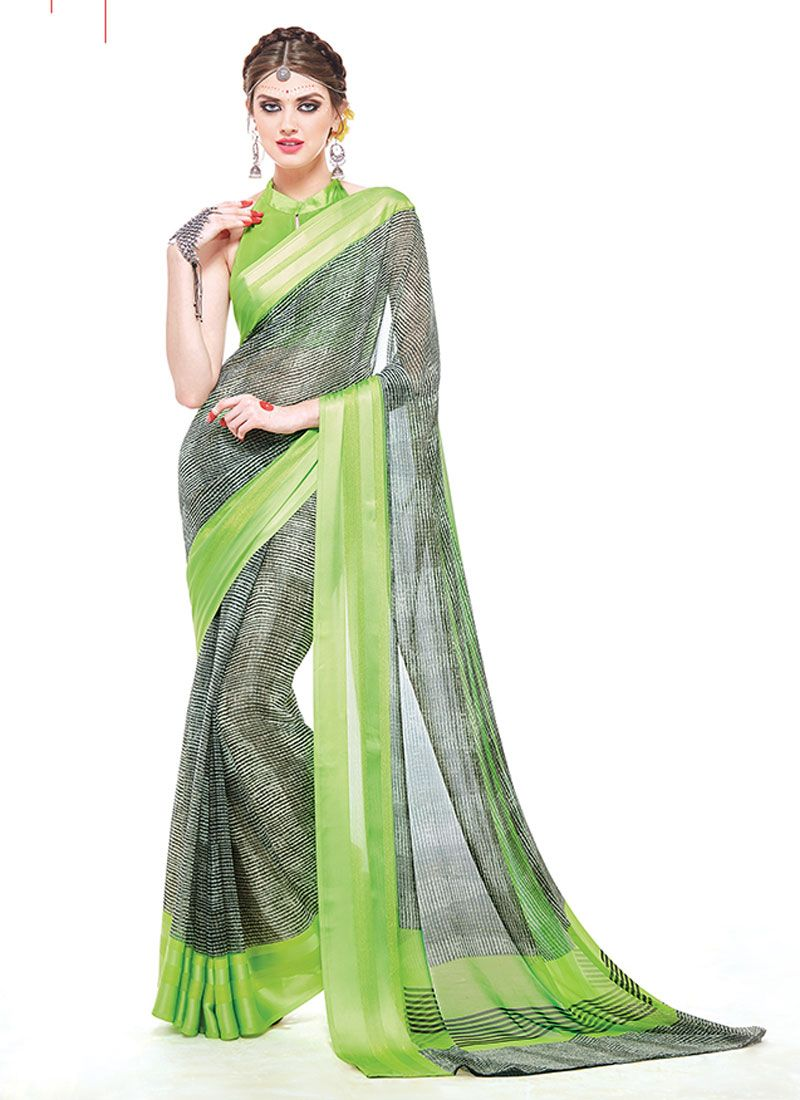 c96ea8a1bb Featuring an impressive green monochromatic print saree with satin silk  jacquard border.It is paired