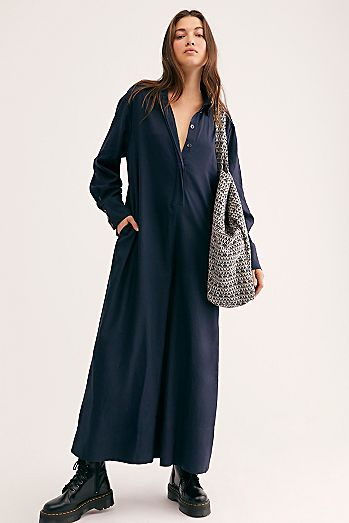 Bambi One Piece Presented by Free People. The slouchiest one-piece featured in a textured cotton fabrication with button-down front detail and exaggerated cropped wide legs.