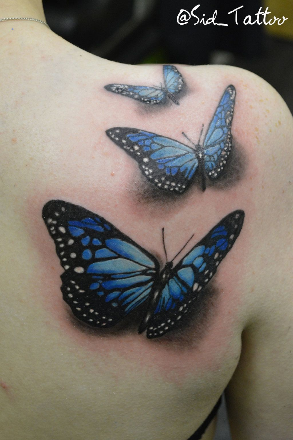 I want to get a three butterfly tattoo, one butterfly for