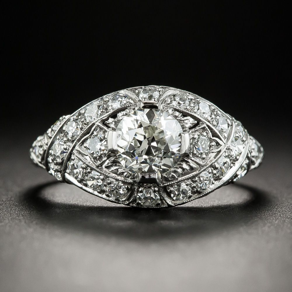 A sleekly styled navetteshaped crown composed of diamond