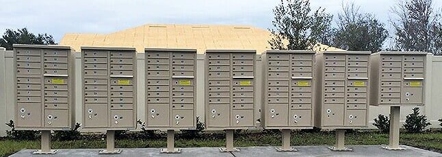 Row of newly installed cluster box units in Sandstone finish.  #mailbox #mailboxes #beautification #decorative #landscape #homeowners #cbu #clusterbox #multiunit #curbappeal #forsite