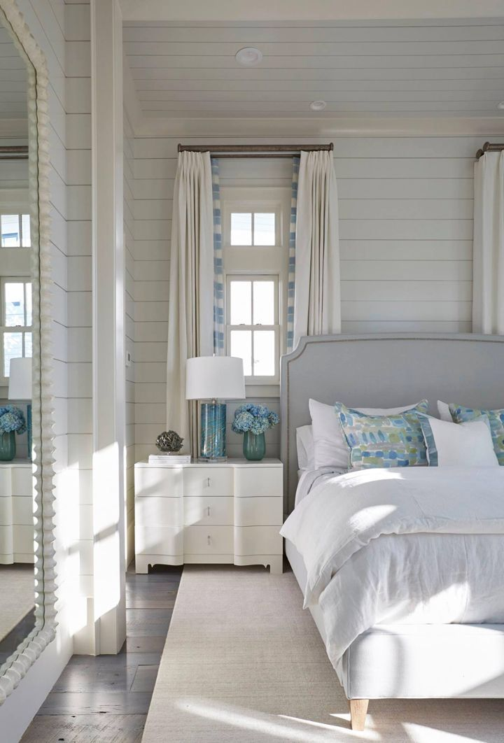 Nightstand In Front Of Window With Hanging Curtain Behind