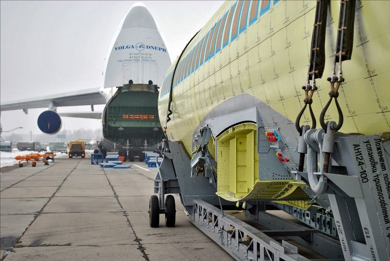 Ruslan plane carries Super Jet new passenger sukhoi jet