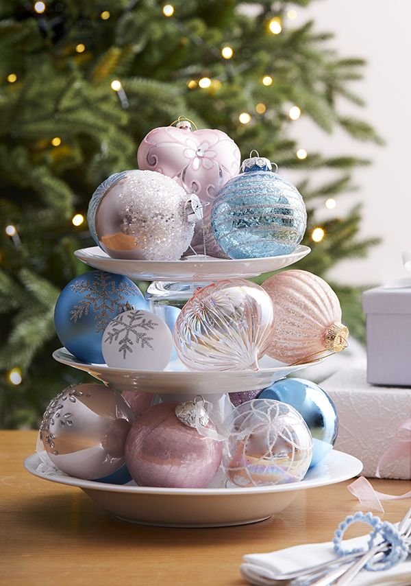 Baubles and ornaments in pretty pastels, whites and silvers are - blue and silver christmas decorationschristmas tree decorations
