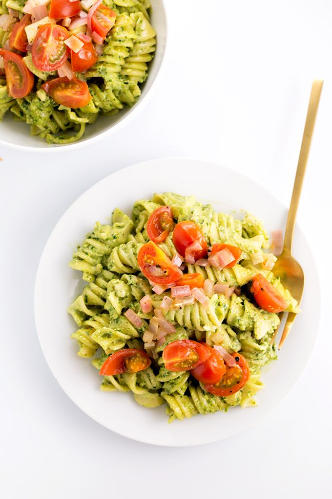 A Simple, Healthy Vegan Spinach Basil Pesto with Pasta, Topped Off With A Cherry Tomato And Red Onion Saute. #vegan #pesto #pasta #simple #healthy #spinach #basil #vegetarian #cheap