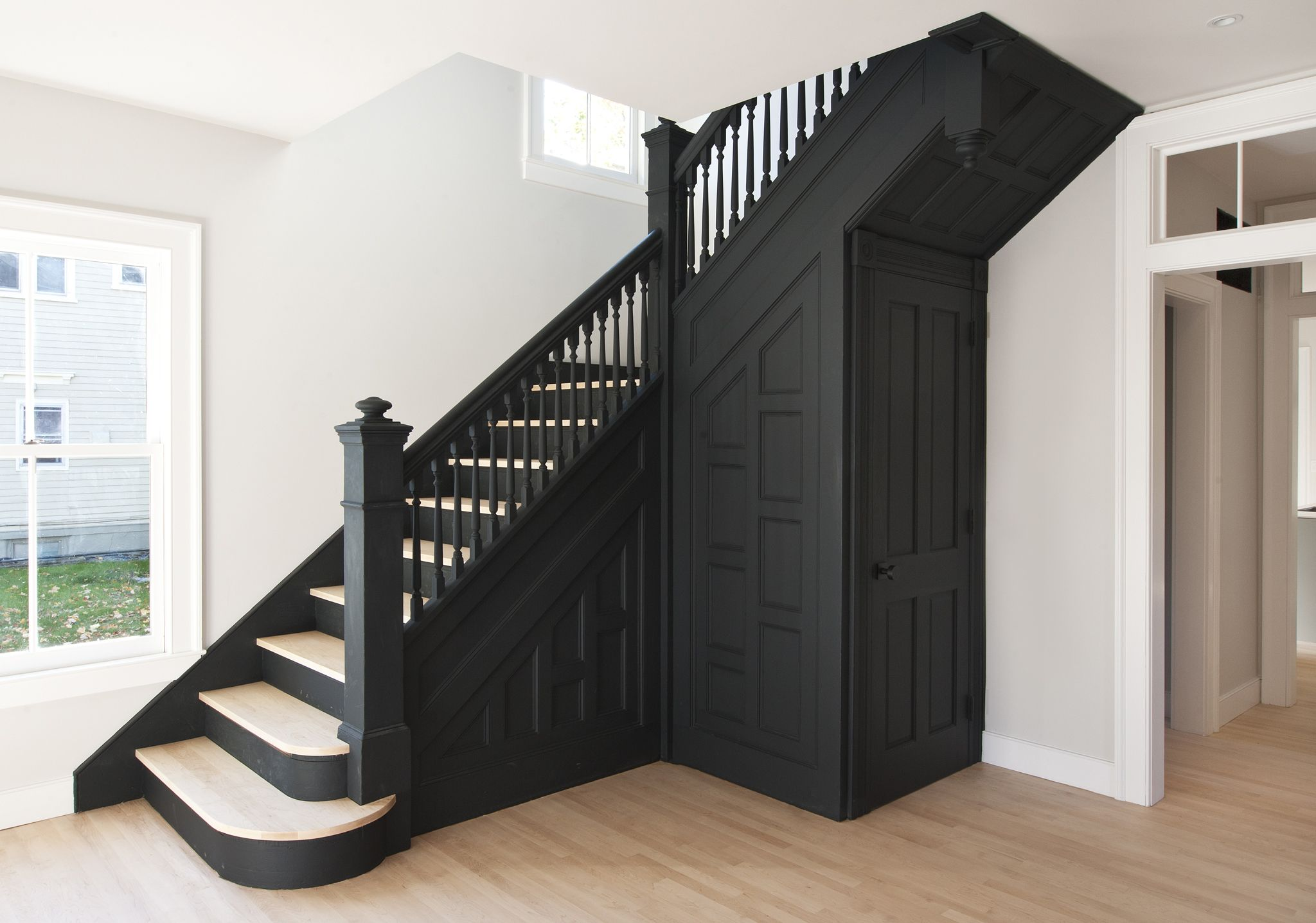 historic stair painted black in modern renovation of turn-of-the-century  Hudson Valley home | Modern renovation, Painted stairs, Staircase design